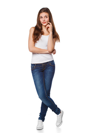 Young beautiful woman thinking looking to the side at blank copy space, full length, isolated over white background