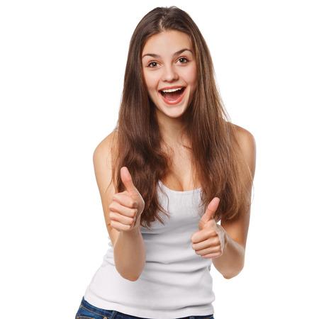 spokojený: S úsměvem šťastná mladá žena ukazuje palec nahoru, izolovaných na bílém pozadí Reklamní fotografie