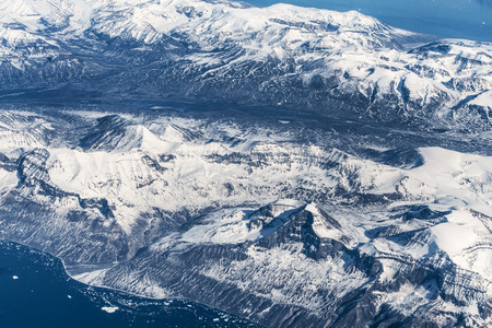 guardianship: Aerial view over ice mountains in Greenland Stock Photo