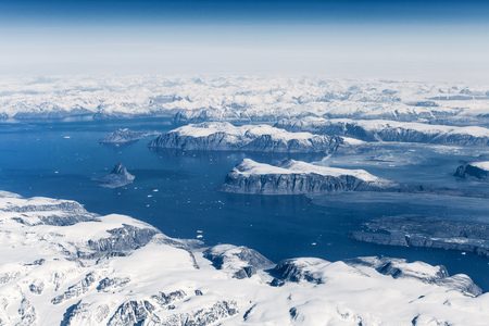 vastness: Aerial view over ice mountains in Greenland Stock Photo