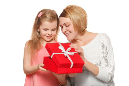 pre: Happy mother and daughter with gift box, isolated on white background