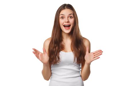 흥분 옆으로 찾고 놀라게 행복 아름 다운 여자. 흰색 배경에 고립 스톡 콘텐츠