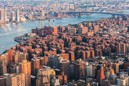 arial view: East Village in Manhattan, Peter Cooper Village. Brooklyn skyline Arial view from New York City with Williamsburg Bridge over East River and skyscrapers