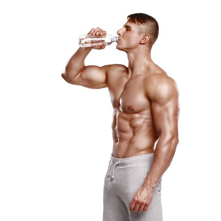 appease: Muscular man drinking water, isolated on white background