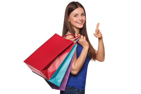 Smile beautiful happy woman holding shopping bags, isolated on white background Stockfoto