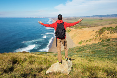 Travel in Point Reyes National Seashore, man Hiker with backpack enjoying view, California, USA