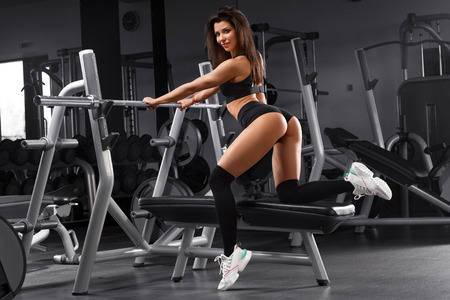 Sexy athletic girl working out in gym. Sexy in thong. Fitness woman