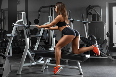 Sexy athletic girl working out in gym. Sexy buttocks in thong. Fitness woman Standard-Bild - 122279060