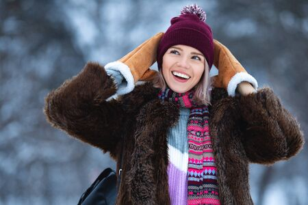 Happy woman in winter time. Excited girl enjoying snowy weather Standard-Bild