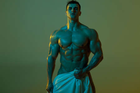 Sexy muscular man  fitness model with towel. Strong male  torso abs