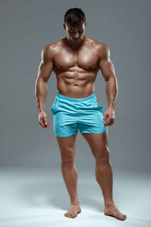 Sexy muscular man fitness model. Strong male  torso abs