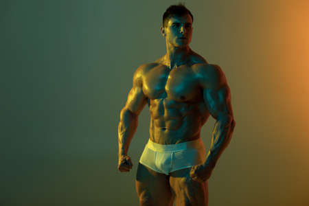 Sexy muscular man fitness model in underwear. Strong male  torso abs