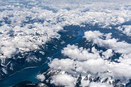 Aerial view over snow mountains Kinbasket Lake, British Columbia, Canada