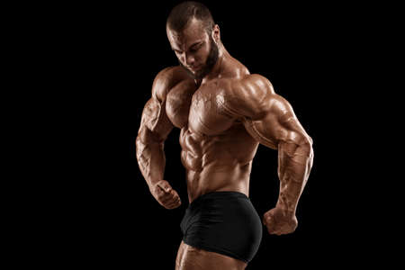 Bodybuilder man isolated on the black background. Strong male naked torso abs Stockfoto