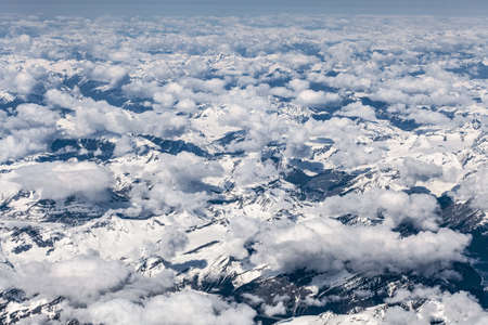 Aerial view over mountains and clouds, British Columbia, Canada