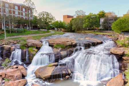 View at Greenville downtown waterfall in Falls park from the hanging bridge. Beautiful, powerful and very attractive for visitors