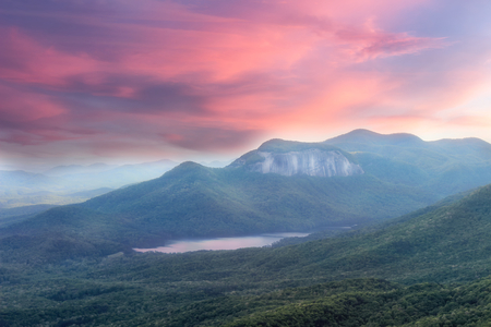 Soft, dreamy sunset view from a Caesars head overlook in South Carolina on a Table rock mountain and lake Imagens