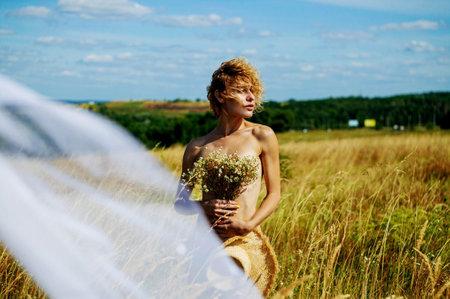 Free Sexy Caucasian Woman In White Underwear Enjoing In Field, Her hair fluttering in the wind.