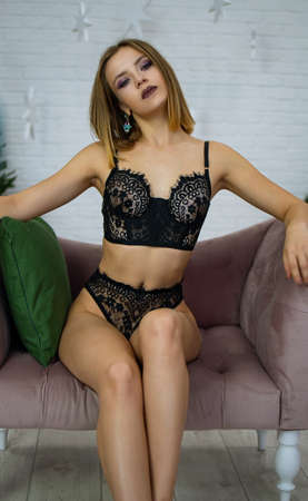 Fashion Shoot Of Young Sexy Blonde Woman In Lingerie