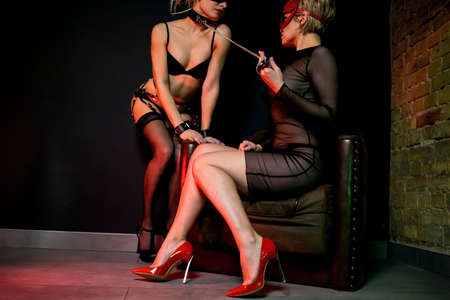 Sexy Lesbian In Mask Dominatrix Touching Her Lover