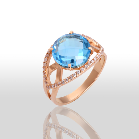 pierced ears: The beauty wedding ring. Isolated on white background. Luxury blue stone. Stock Photo