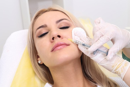 filler: Beautiful girl on rejuvenation procedure in beauty clinic filler injection.