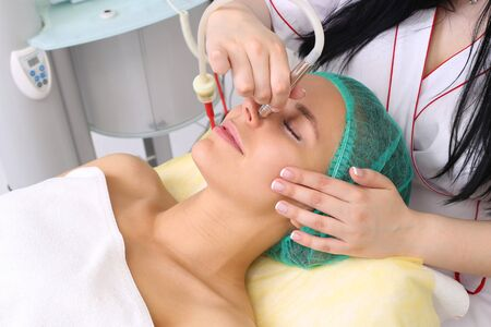 exfoliation: Procedure of Microdermabrasion. Mechanical Exfoliation, diamond polishing. Model, close-up. Cosmetological clinic. Medical equipment. Healthcare clinic cosmetology