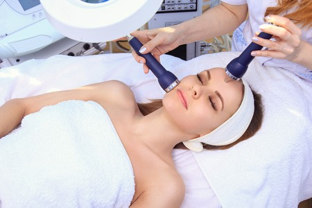 Ultrasound cavitation anti-aging, lifting procedure. Stock Photo