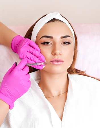 Procedure filler injection in beauty clinic. Stock Photo