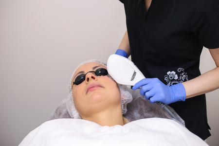 Photo Facial Therapy. Anti-aging Procedures. Stock Photo