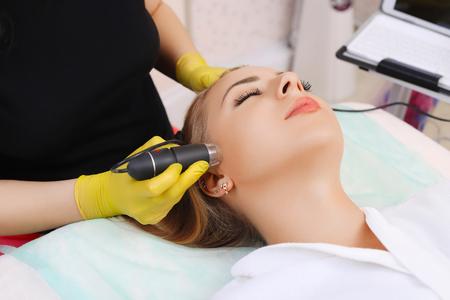 Woman visiting dermatologist at clinic.