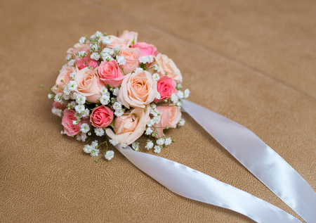 Elegant grooms boutonniere with beautiful roses. Фото со стока