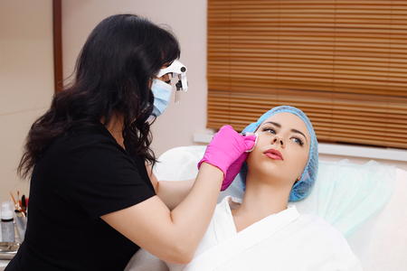 Mesotherapy injections in the face.