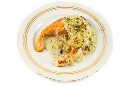 Fried salmon fillet with blue cheese sauce photo