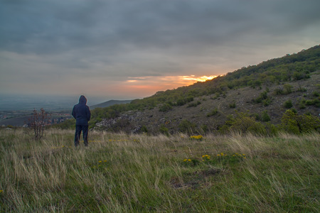Man waiting for the sunrise over the mountains photo