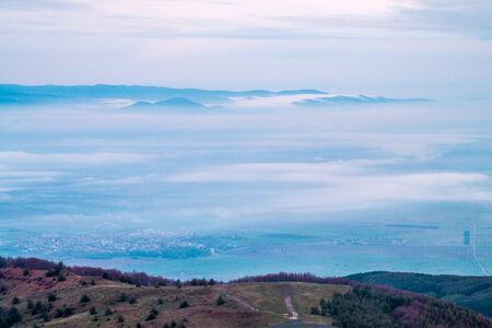 Above the clouds on Buzludzha peak photo