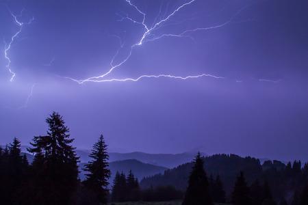 Thunderstorm over a mountain range near Pamporovo, Bulgaria photo