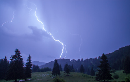 bolt: Thunderstorm over a mountain range near Pamporovo, Bulgaria Stock Photo