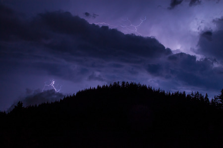 Thunderstorm over a mountain range near Pamporovo, Bulgaria photo