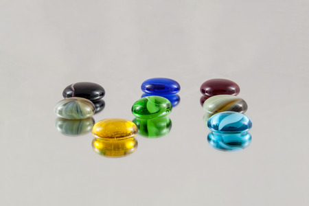 Arranged glass gems with blurred reflections Stock Photo