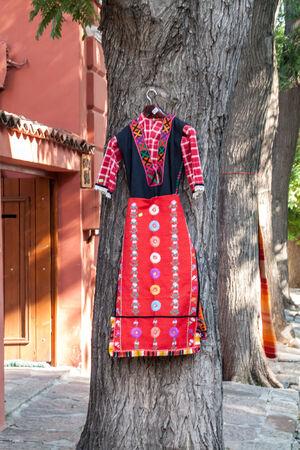 bulgaria girl: Bulgarian tradidtional folk costume hanging on a tree Stock Photo