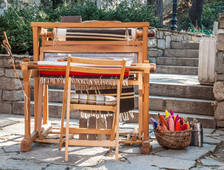 traditional culture: Antique loom machine. Bulgarian traditional culture. Stock Photo