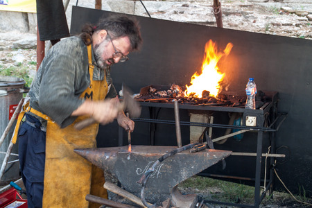 medieval blacksmith: Blacksmith working on his next masterpiece
