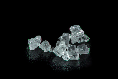 extreme macro: Extreme macro photography of sugar crystals on a black background Stock Photo