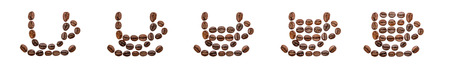 amounts: Five coffee cups arranged from beans and filled with different amounts Stock Photo