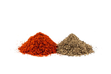 grinded: Piles of red and black pepper powder Stock Photo