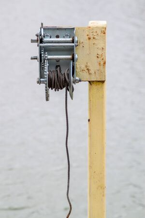 winch: Rusted Boat towing winch with a steel rope