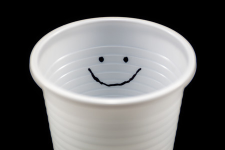 White plastic cup with a smiley face inside photo