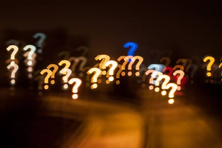 Question mark qustom bokeh. City street lights. Stock Photo