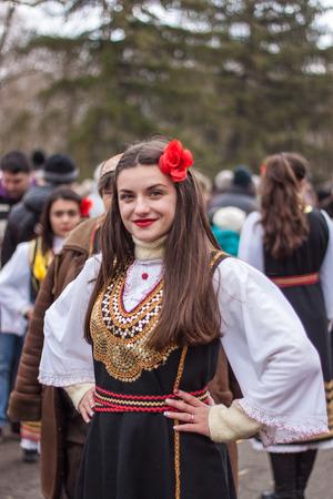 YAMBOL, BULGARIA - MARCH 08, 2015 - Kukerlandia - mask festival and masquerade games 08 March 2015. Bulgarian traditional dances and costumes called Kukeri.